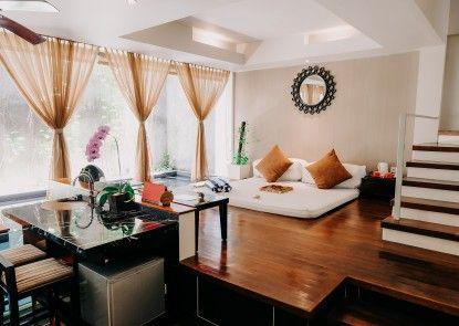 18 Suite Villa Loft by AMITHYA Ruang Tamu