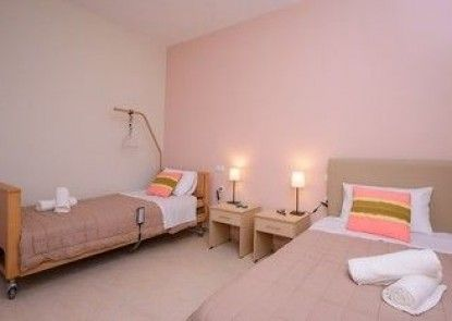 Aksos suites Accessible Accommodation