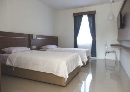 Alzara Hotel Kamar Tamu