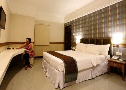 Amarelo Hotel Solo Kamar Tamu