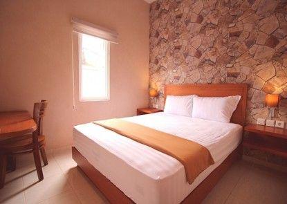 Amaya Suites Hotel Kamar Tamu