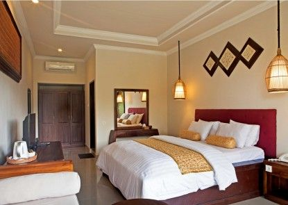 The Artini Resort (Formerly Artini 3 Cottages) Kamar Tamu