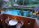 Pesan Kamar Kamar Double Standar, 1 Tempat Tidur King, Pemandangan Kolam Renang di Cocco Resort