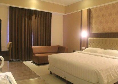 COR Hotel Purwokerto Kamar Tamu