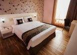 Pesan Kamar Deluxe Room Queen Bed di Grand Sovia Hotel