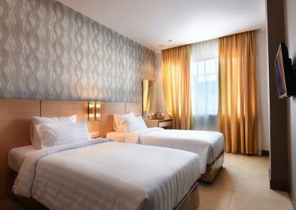 Grand Impression Hotel Medan Kamar Tamu