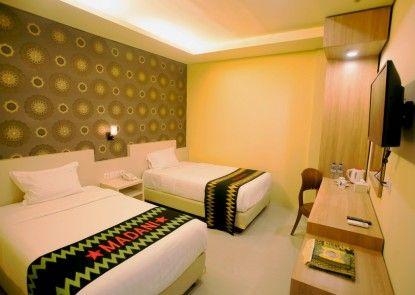 Grand Madani Hotel by Prasanthi Syariah Kamar Tamu