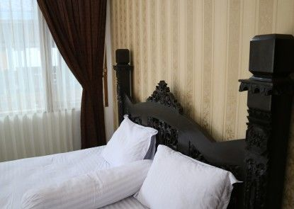 GRIYA LIMASAN HOTEL Ruangan Suite