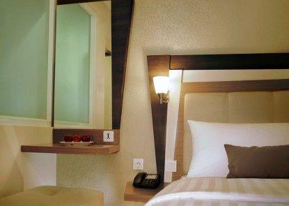 Hotel Neo Kuta Jelantik Kamar Tamu