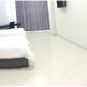 Studio Inn And Suite Semarang Kamar Tamu