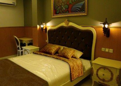 Grand Batik Inn Kamar Tamu