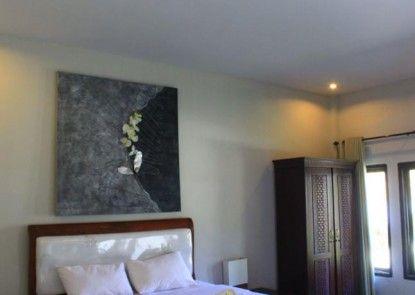 JM Hotel Kuta Lombok Kamar Tamu