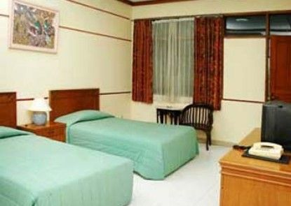 Lembah Sarimas Hotel and Resort Kamar Tamu