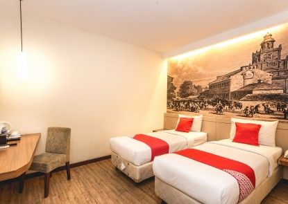 OYO 110 Feodora Hotel Kamar Tamu