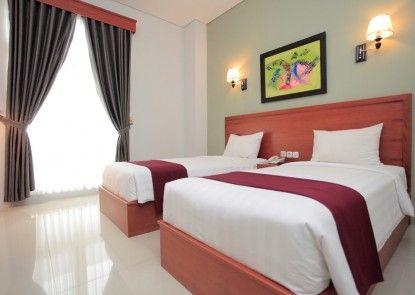 PRIMA SR Hotel & Convention Kamar Tamu