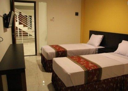 Prime Cailendra Hotel Kamar Tamu