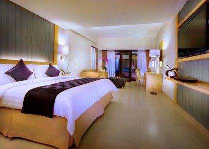 Quest Hotel Kuta Kamar Tamu