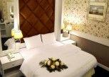 Pesan Kamar Grand Deluxe Room di Raya Grand Hotel