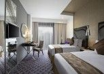 Pesan Kamar Deluxe Twin Bed di The Bellevue Suites