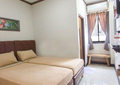 Tasik Jogja Hotel Kamar Tamu
