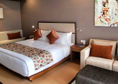 VOUK Hotel & Suites Kamar Tamu