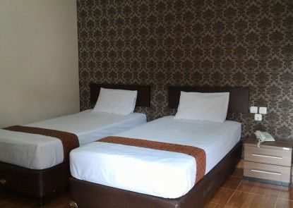 The Tiara Hotel & Resort Kamar Tamu